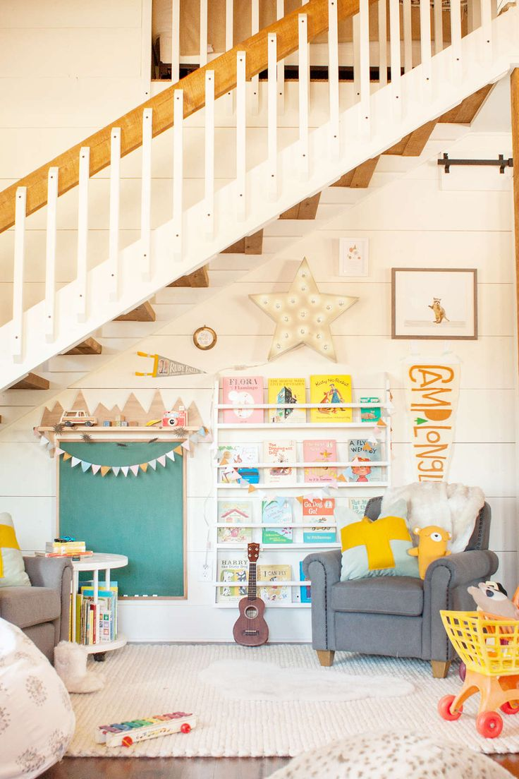 lay baby lay south georgia farmhouse playspace reveal. featuring our wood book display shelves, mini club chairs, vintage spool side table, printed dandelion bean bag, vintage illuminated star, baby raccoon portrait, sheepskin cloud wool rug, chunky braided wool rug and luxe faux fur throw.