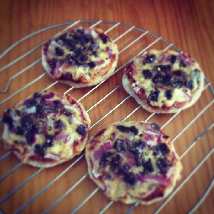 Puff pastry mini pizzas :) delish, these are red onion, beef snitzel, cheese, and the sauce of your choosing :) easy simple and quick to make