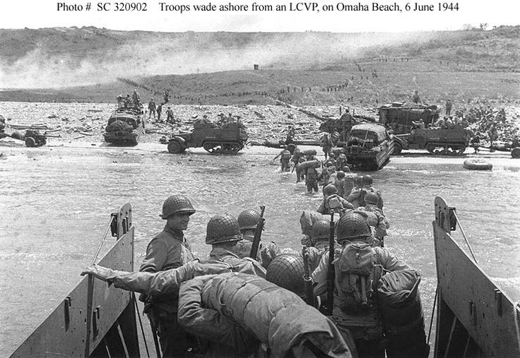 Troops Wade Ashore at Omaha Beach Famous Historical Events World War II.