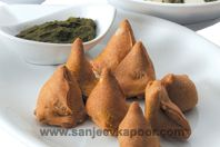 Baked vegetable samosa from top Indian chef Sanjeev Kapoor. Ajwan seeds in the pastry seems to be traditional - see this recipe, which also has interesting filling - http://www.indianfoodforever.com/snacks/samosa.html
