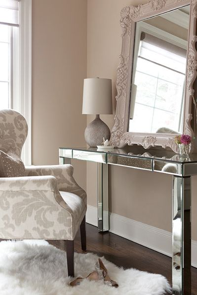 Mirrored desk with neutral decor