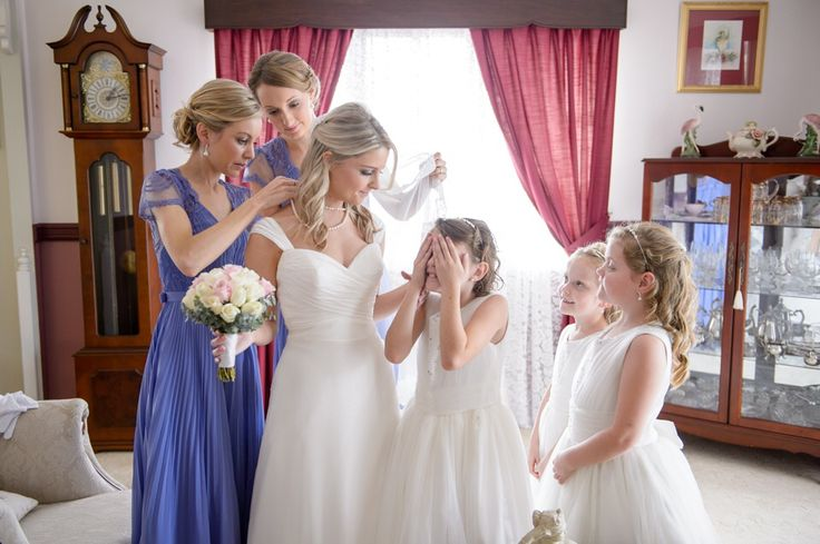 Purple vintage bridesmaid gowns with lace back. white flower girls. Half up half down hair for flower girls