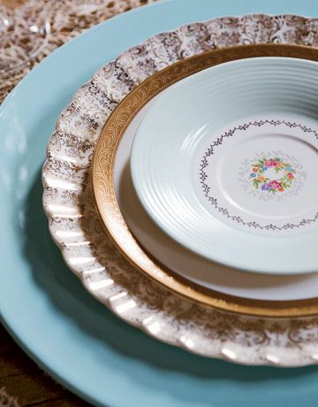 """I really love mix and match vintage plates for table settings. It's been my goal to have something like this at my reception for years!  Image via Country Living; search for either """"plates"""" or """"table setting."""""""