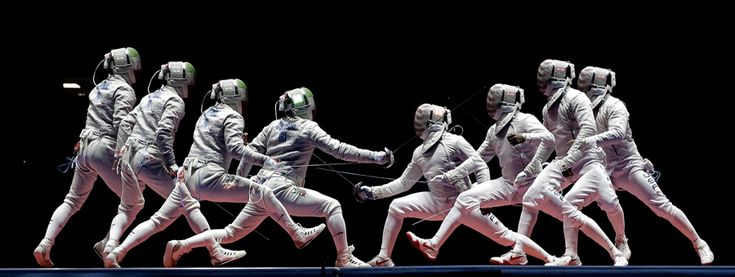 In a photo taken using multiple exposure, Iran's Mojtaba Abedini, left, and United State's Daryl Homer compete in a men's individual sabre semifinal on August 10, 2016. #  Charlie Riedel / AP
