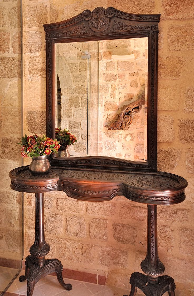 "EXCLUSIVE SUITES BOUTIQUE HOTEL. MEDIEVAL TOWN, RHODES, GREECE. -  ""Key table"" with mirror from a Greek home in Alexandria, Egypt. Hand carved walnut tree wood, ca 1920. Such furniture was placed near the main entrance of a residence. They were called ""the Gossiper"" as they could know who and when entered and left the house. - kokkiniporta.com"