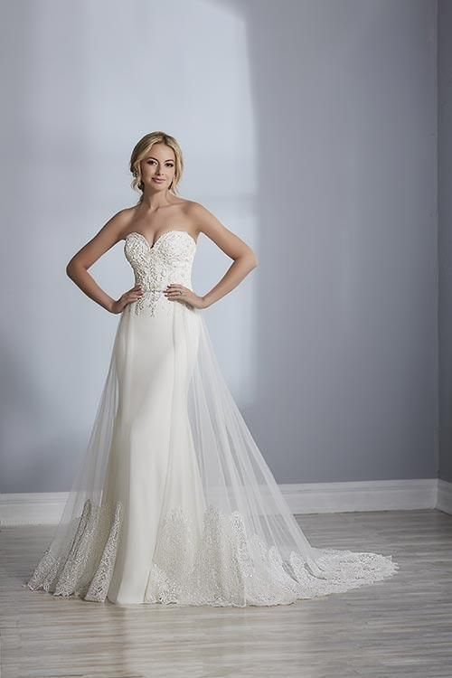 801a8e11965a Jacquelin Bridals Canada - 19112 - Wedding Gown - A detachable tulle  overskirt sits on top a fitted crepe gown on this fashion forward gown.