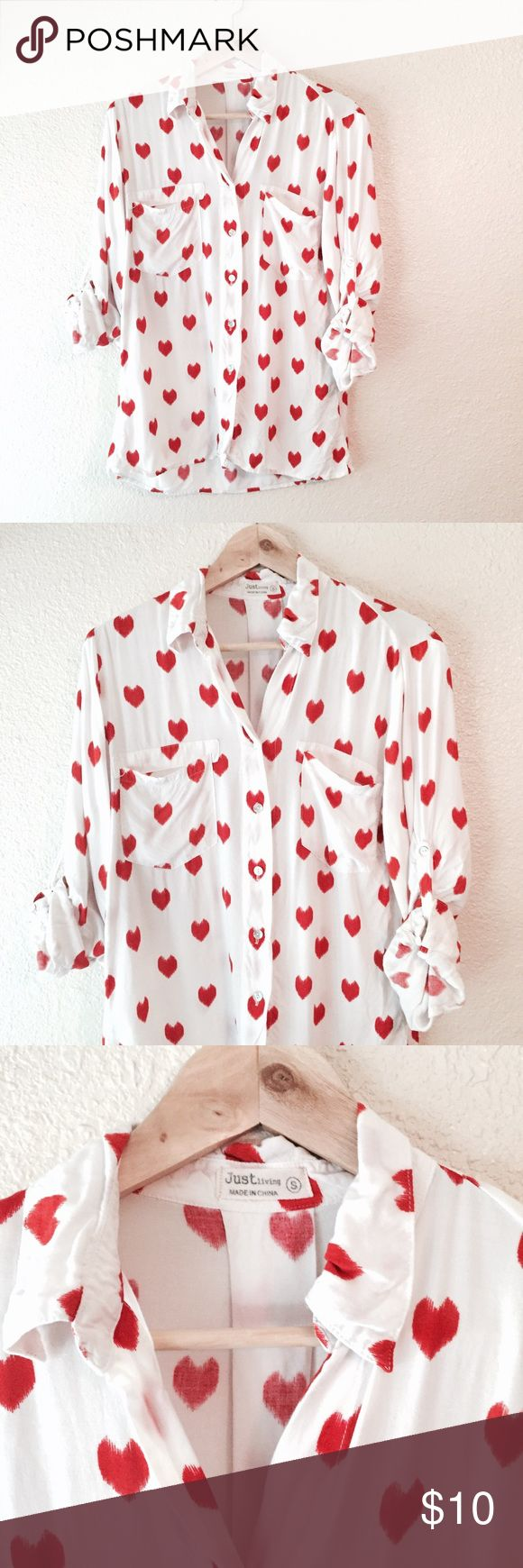 White button down shirt with red hearts Blouse S Lovely and adorable! White button down blouse with light red hearts printed across the entire shirt. Roll up sleeves with a strap and button. Front pockets. Loose fitting and super soft fabric! Has a little bit of noticeable wear. Just living brand, size small. Just Living Tops Button Down Shirts