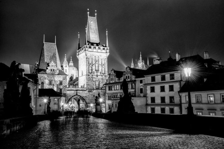 Prague's famous Charles Bridge taking on a bit of a Gotham-like feel on a stormy October night. The bad weather wasn't nearly enough to stop the crowds from enjoying this gorgeous city at night though. by kristinrepsher