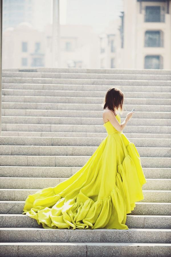 The light catches the fluorescent dress to make it stand out in this photo