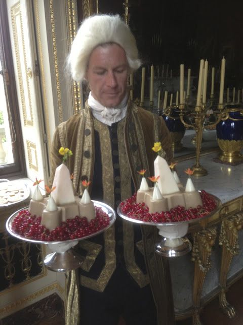 A footman struggles with two flummery Solomon's Temples, a Georgian signature dishes, served at Harewood House.