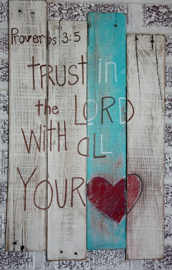 Proverbs 3:5 Trust in the Lord with all your heart painted on a pallet that has 3 white boards and one teal board.