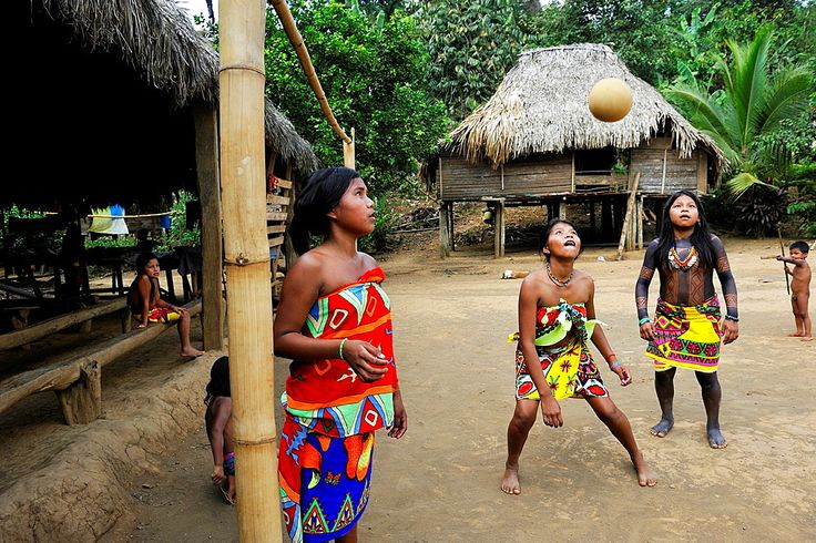 young girls playing football on a village's square of Embera native community living by the Chagres River within the Chagres National Park, Republic of Panama, Central America – 817-430554