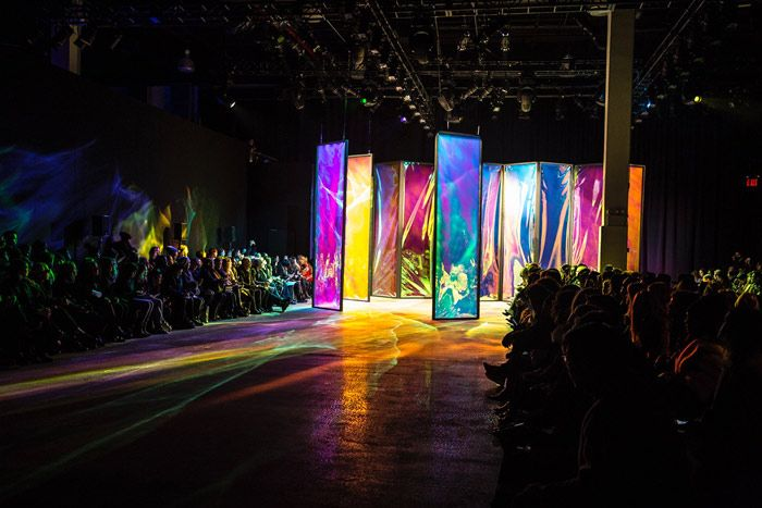 A new 3M material called Dichroic glass film that, when placed in specific angles, reveals a stunning reflection of the entire color spectrum of light. The abstract light refractions juxtaposed strikingly against an otherwise all-black venue, provides extra impact..
