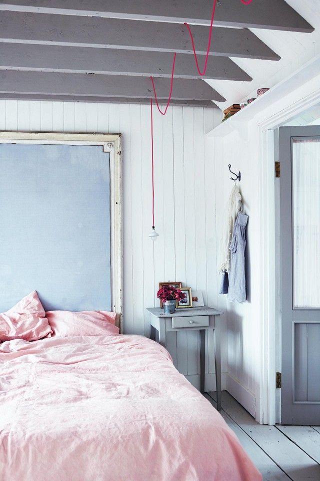 Feminine yet minimal bedroom with pendant lamp