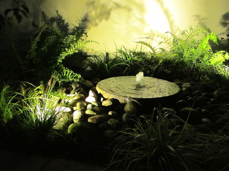 A water feature can add more drama after dark with good LED garden lighting.