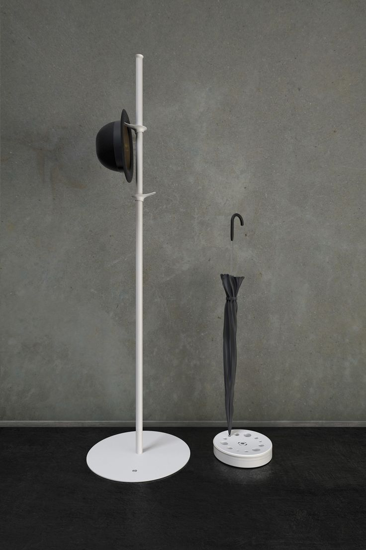Pine coatstand and Disc umbrella stand in white by Teun Fleskens for RiZZ   the entrance collection. Pine, the leaves are made from biological plastic and can be easily adjusted in height. The disc is fun to use, holds any stick umbrella!