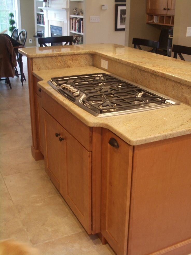 maple kitchen cabinets stainless steel cooktop granite countertops travertine floor diamond cabinets