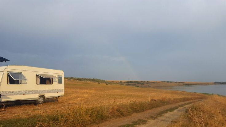 perfect view with lake and rainbow with the caravan