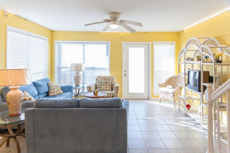 Take a tour of Martha and Alex's renovated Comfort Breeze living room, as seen on HGTV's Beach Flip.