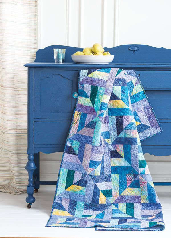 Kris Peterson transformed a gift of pre-cut batik strips into this great quilt. Watch the Fons & Porter staff show you how to make this quilt. Digital pattern available.