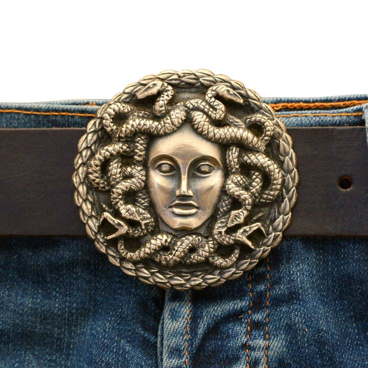 "Medusa symbolizes protection against evil, warning to enemies, and feminine power. 2 7/8"" diameter, hand-sculpted, solid brass belt buckle. Belt strap sold separately. Free shipping in the U.S."