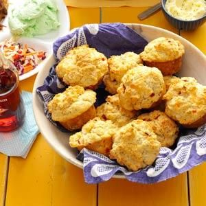 Rustic Garden Herb Biscuits Recipe -The rosemary butter takes warm biscuits to another level. I use herbs from the garden but dried work, too. —Michelle Gauer, Spicer, Minnesota