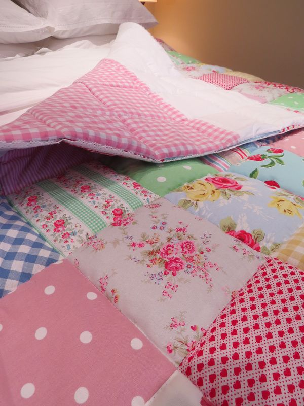 Make A Simple Patchwork Quilt - Rosie Buttons: click to see a picture of the full quilt, so pretty with the lace edging