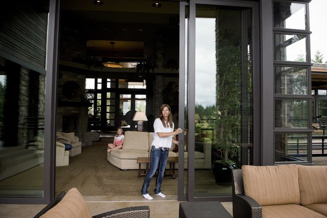 """Anita and Bob Dethlefs moved into their new Portland 13,000-square-foot home in November. The Frank Lloyd Wright-inspired home has about $300,000 worth of windows to help with the """"grey sky"""" malaise Ms. Dethlefs, shown here, says she gets living in the Pacific Northwest."""
