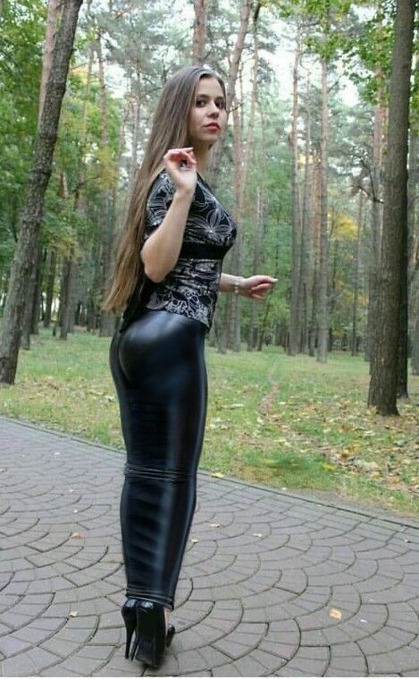 Girl in a woodland wearing a long black latex hobble skirt ...