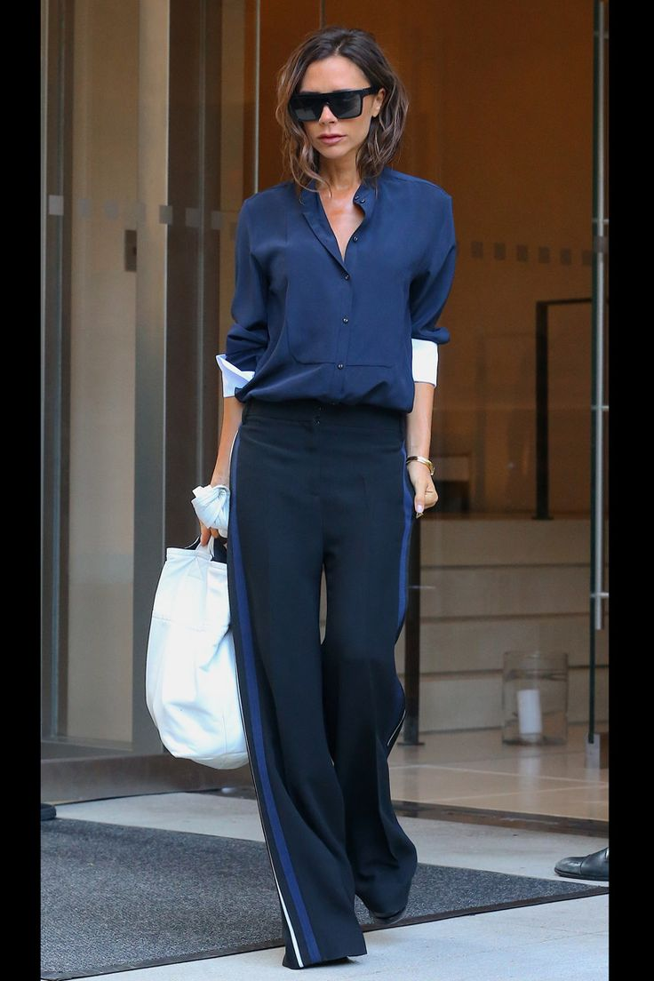 Victoria Beckham styled V neck blouse with wide leg pants.  Shop similar vneck blouse on siizu.com