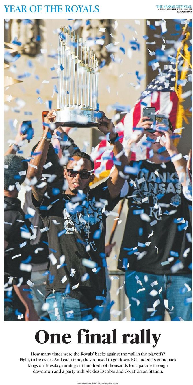 Kansas city royals alcides escobar stands with the trophy during tuesday s kansas city royals baseball world series celebration on november 2015 at union