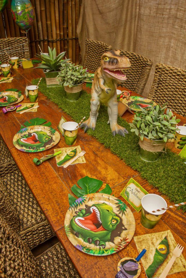 Dinosaur Birthday - i like the idea of a grass mat and/or plants as a centerpiece on the dining room table