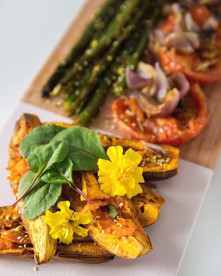 Monday dinner inspo... Slow baked caramelised sweet potato asparagus red onion & tomato in olive oil  coconut nectar with herbs greens & edible flowers from our garden... It was so good we ate the extras I set aside for lunch tomorrow ... Served on our gorgeous new plank from @houtenplank1 and you can see @liana_kathryn profile for the full shot from above... Will share recipe soon!  #nomeatmonday #vegetarian #vegan #veganfoodporn #veganfoodshare #vegannewcastle #foodstyling…