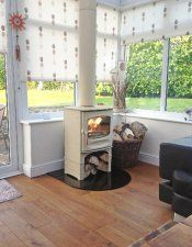 Charnwood C-FIVE in almond stove in conservatory
