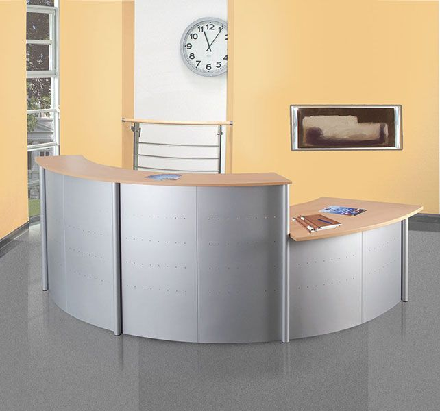 Genua Curved Reception Desk Genua curved reception desk in three 45 degree sections two full height and one desk height. Steel fronts in a aluminium silver finish and desk and counter tops in beech. Available for a 7-10 day lead time. Easy assembly and optional installation service.