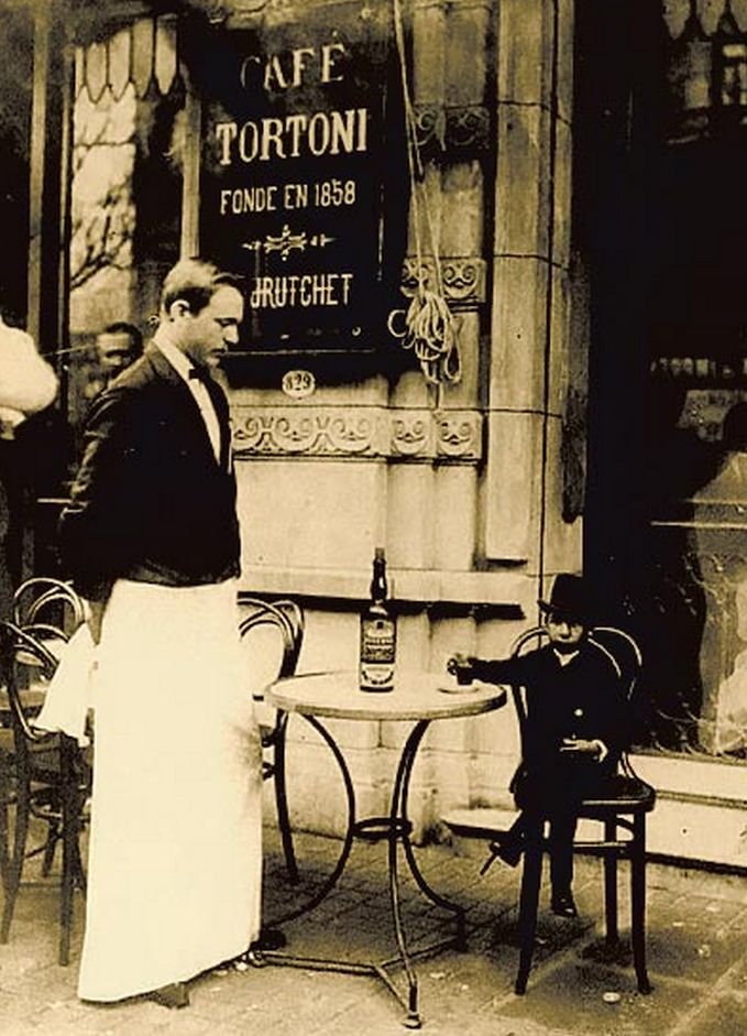 Cafe Tortoni in Buenos Aires, Argentina, since 1858 (still there). I have no idea what's going on in this photo...