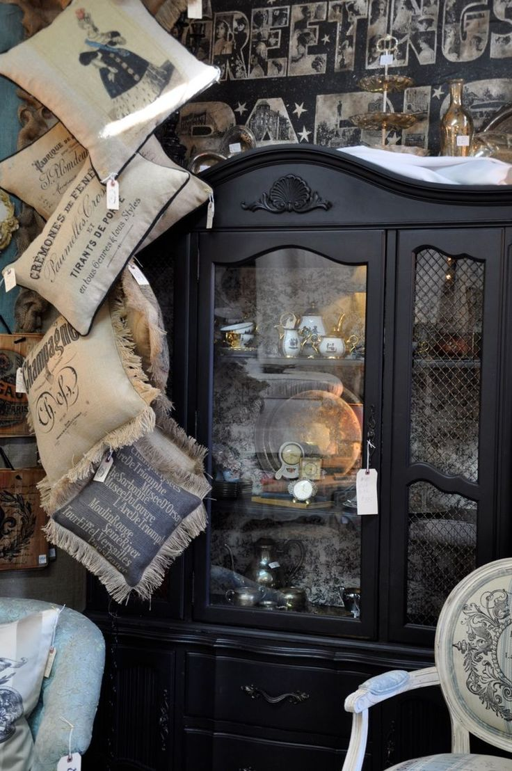 dark cabinet makes a nice change and focal point: Black Paintings, Display Hutch, Pillows Display, Dark Cabinets, Storage Cabinets, Black Display, Stores Display, Black So, Black Hutch