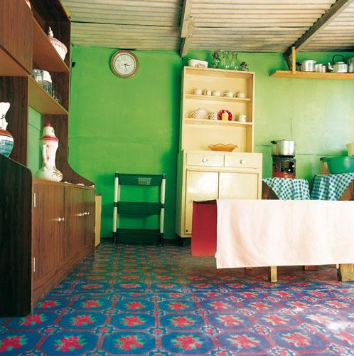 Shack chic: Residents experiment with wall and floor colours. From the book, Shack Chic, a collection of photographs celebrating the art and innovation of slum dwellers in South Africa. | www.quivertreeimages.com