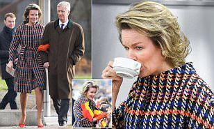 Queen Mathilde of Belgium, 44, wrapped up against the chilly winter weather in a bold houndstooth coat as she carried out engagements in Flemish Brabant with husband King Philippe.