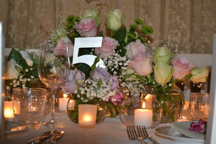 Love this table décor! Layers of flowers and low candles combine to create an opulent setting.
