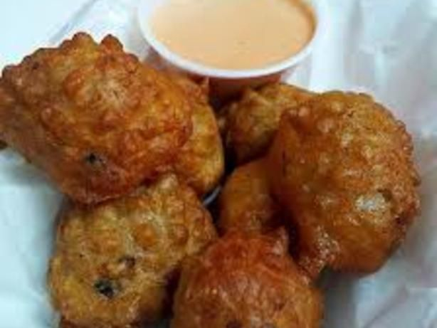 Bahamian Conch Fritters.  Conch can be replaced with any seafood. Make this batter with calamari, shrimp, imitation crab meat and lobster And see how awesome it turns out. Read about CONCH on the web, its interesting. BEWARE - these are HOT.
