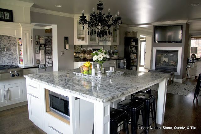 This kitchen with sex appeal has blue ice granite for Kitchen counter sex