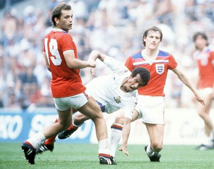 England 3 France 1 in 1982 in Bilbao. Jean Tigana gets a half shot away with Ray Wilkins in attendance in Group 4 at the World Cup Finals.