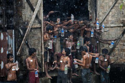 World Water Day 2016 Bangladeshi and Rohingya migrants who were found drifting at sea collect rain water at a temporary shelter in Myanmar's northern Rakhine stateAFP