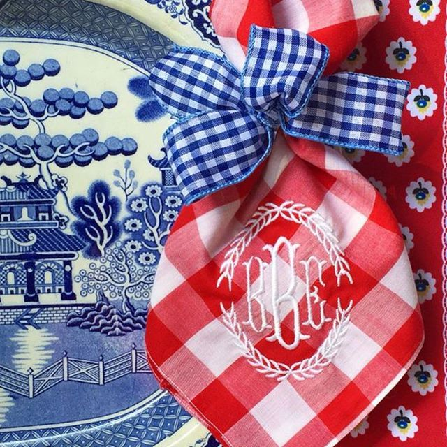 Festive table setting with cute red gingham napkins paired with blue willow - Laurie Byrne
