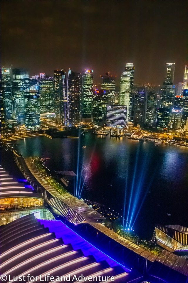 Light show looking over Singapore harbor from the Marina Bay Sands hotel.