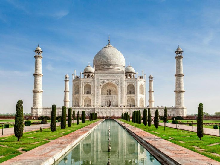 Taj Mahal in india. Constructed as a monument of love by the mughal emperor Shah Jahan in memory of his adored wife, this iconic white marble mausoleum in Agra is steeped in romance. Built in 1653, thousands of artisans were employed to carve the magnificent archways, domes, and ceilings. Inside, the octagon-shaped inner chamber is inlaid with dazzling precious and semi-precious stones.