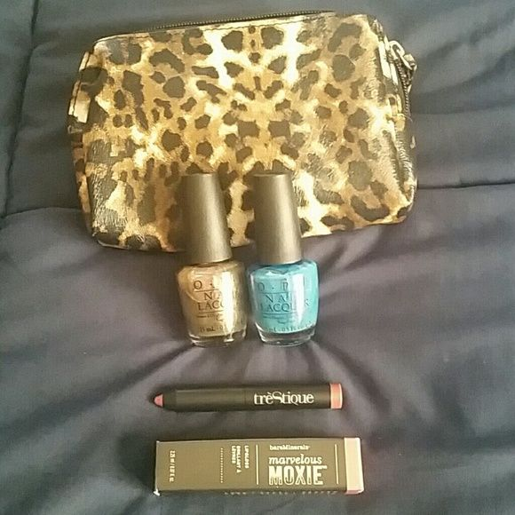 Beauty bundle! Such a great steal!  Two unopened OPI nail polishes (names of the color shown in picture), one unused bare minerals marvelous moxie lip gloss in spark plug shade, one unused  treStique  mini matte lip crayon, and one cheetah patterned make up bag. bareMinerals Other