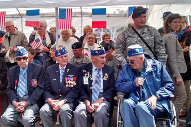 US veterans of the D-Day invasion in World War II prepare to be honored at a ceremony in La Cambe, France, June 6 2014