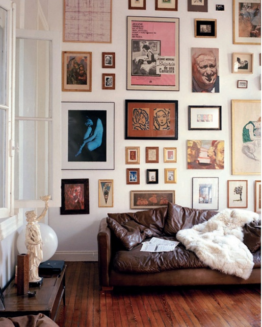 An eclectic art wall just like this, but with white frames, a white couch and gray-green walls for my sunroom